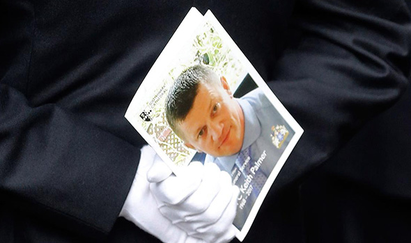 PC Palmer's funeral service book clasped in white gloves